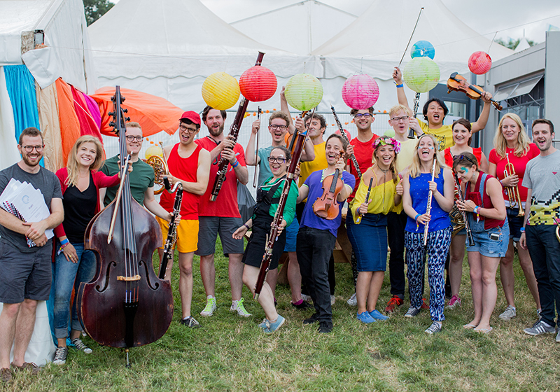 Army of Generals and Paraorchestra pose with instruments backstage at Glastonbury Festival 2017