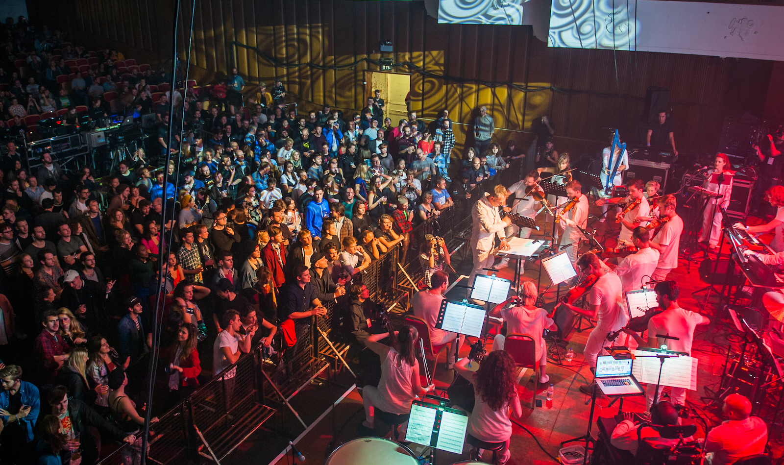 Charles Hazlewood conducts Army of Generals and The British Paraorchestra at Simple Things, Colston Hall, 21 October. Image taken behind the stage and shows orchestra, conductor and audience.