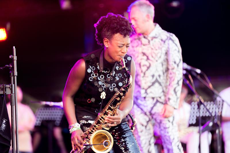 Yolanda plays saxophone, stage lighting,