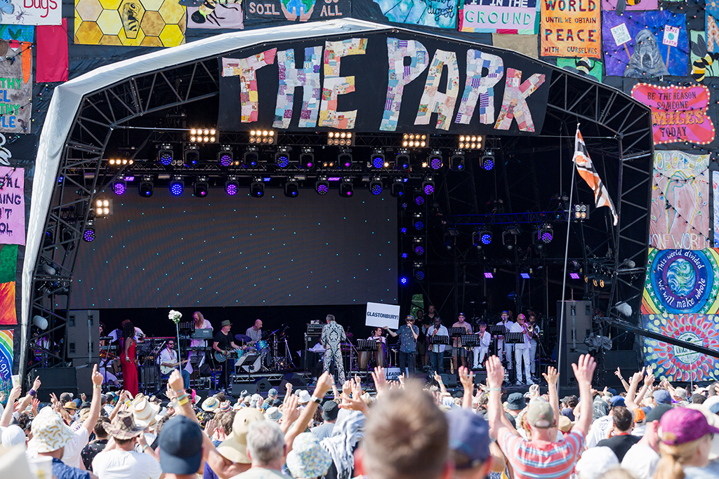 Festival stage, crowd in foreground, The Park sign above
