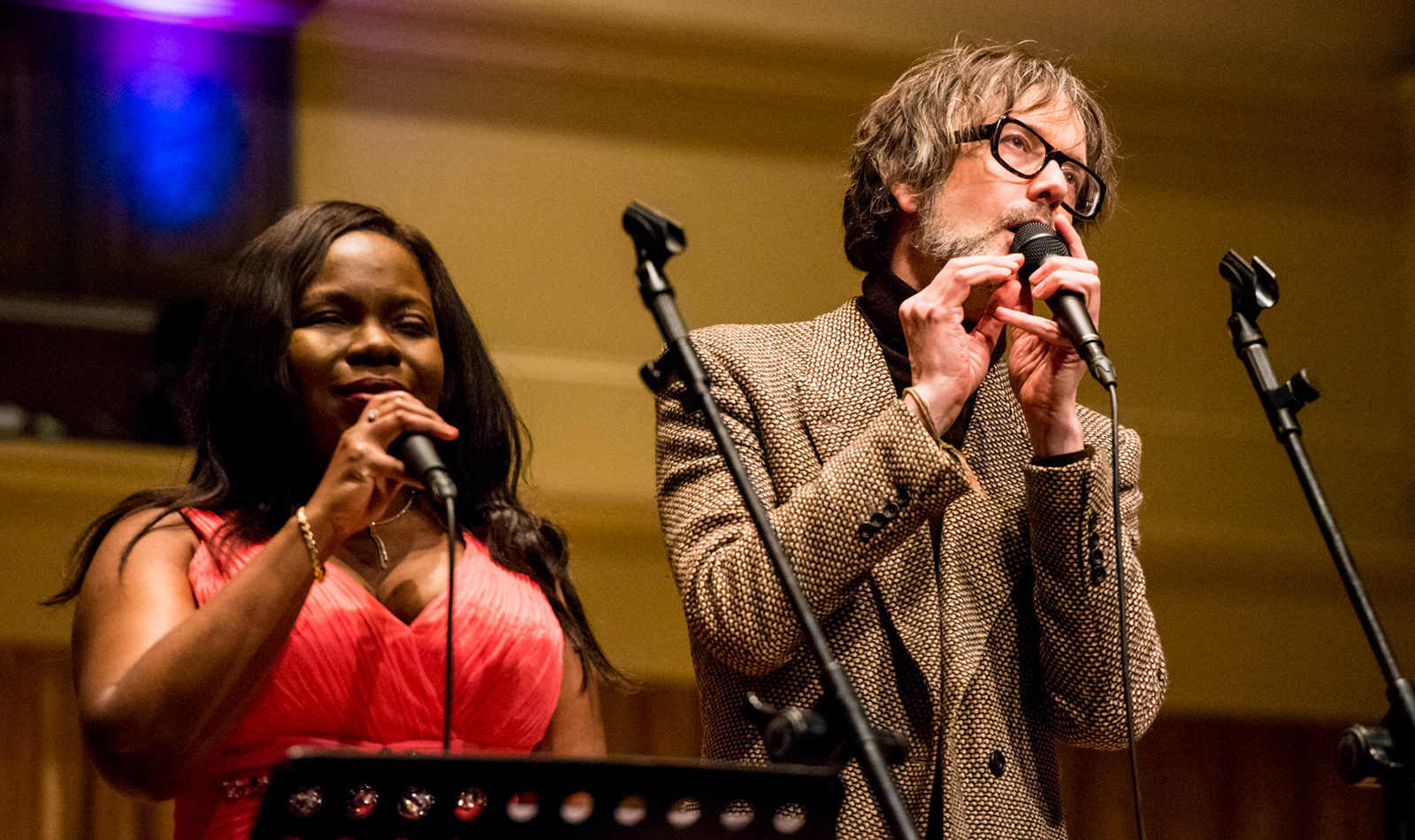 Jarvis Cocker and Victoria Oruwari sing together on stage, holding microphones