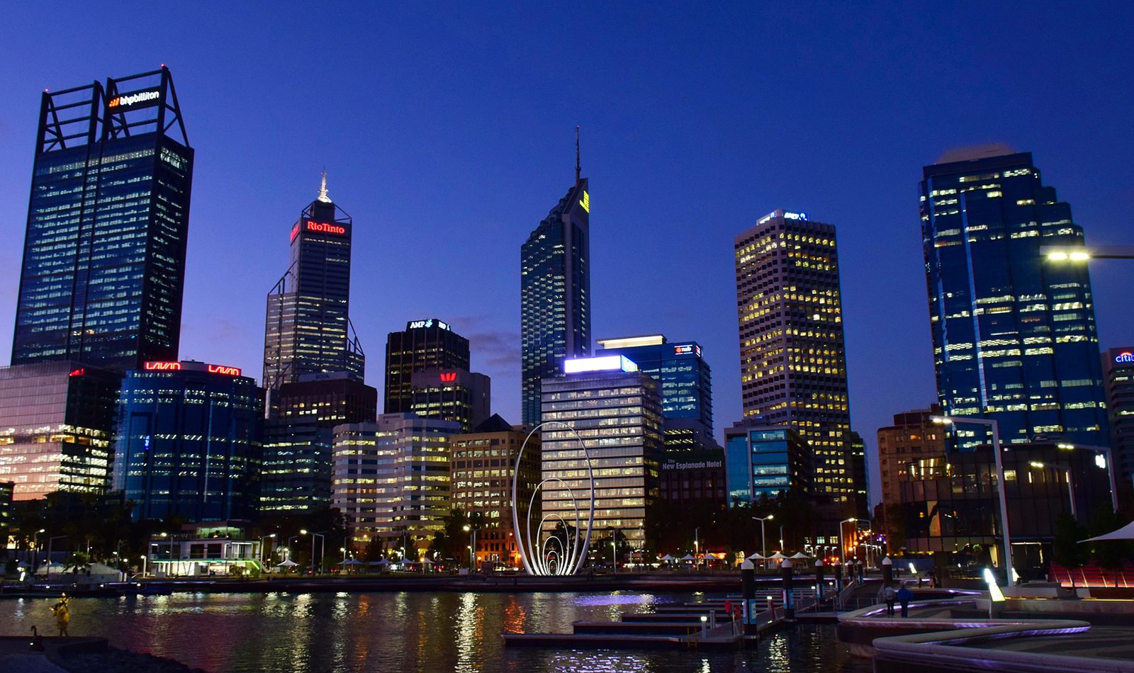 Downtown Perth at night, brightly lit skyscrapers and the docks in the foreground