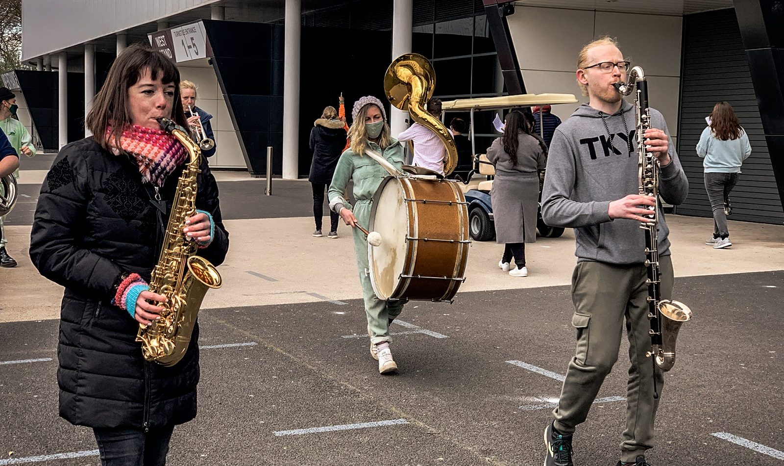 Musiians playing outside on the move